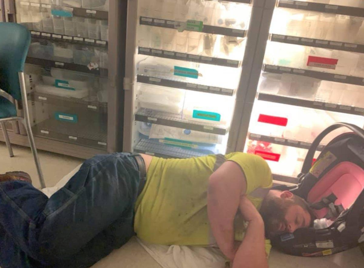 viral photo of dad sleeping on floor reveals equal parenting