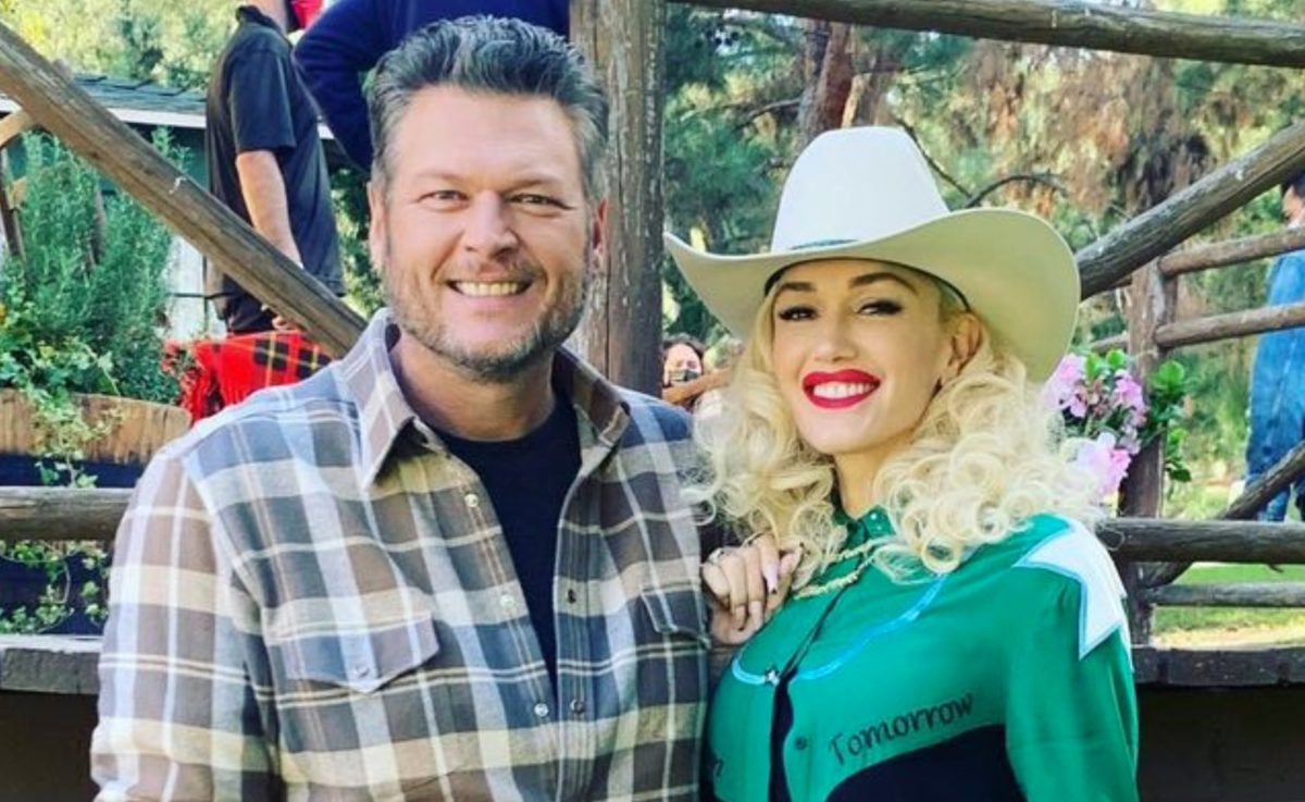 blake shelton and her 3 son with her wedding dress while shelton made everyone cry with his surprise wedding gesture