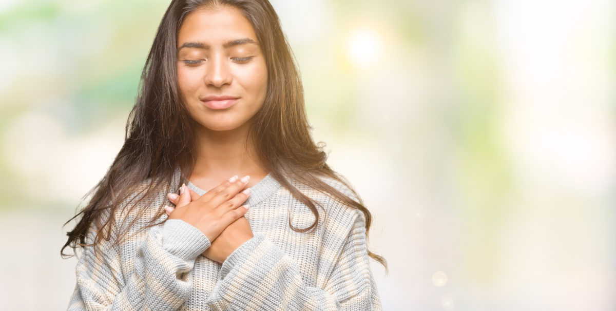 grateful hand over heart