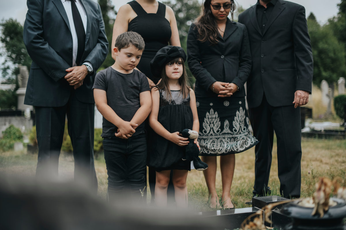 aita for allowing my kid's to be at their father's funeral?
