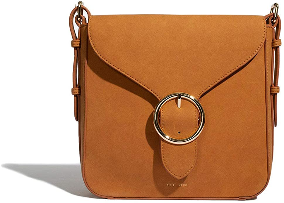 this is the small crossbody purse you need! durable, quality, and fits it all